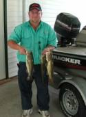 Ricky with a couple of buzz bait bass.