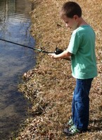 Young Man fishing from Shore