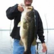 Greg from Southlake with a bass just under 9 lbs, caught on a watermelon Top Dog Lizard