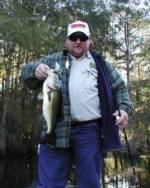 Ricky with a Chicot Lake bass.