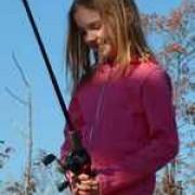 Logan Redd fishing with her Dad.