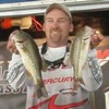 Mike Cork with two bass weighed in at the AFT AOY